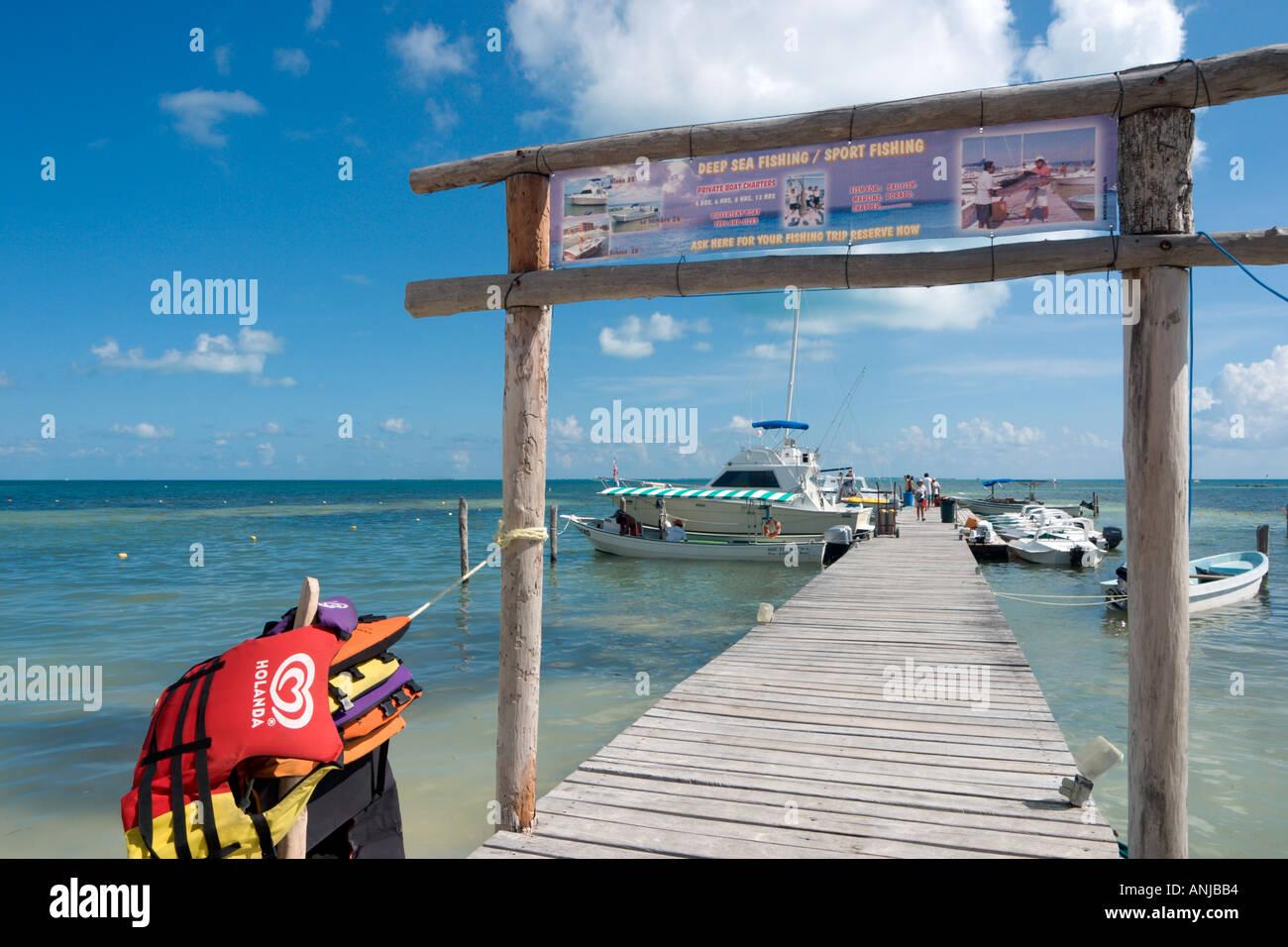 Jetty and Boat Charter on beach at far north of Cancun c Kilometer Marker 4 (KM4), Cancun, Yucatan Peninsula, Mexico - Stock Image