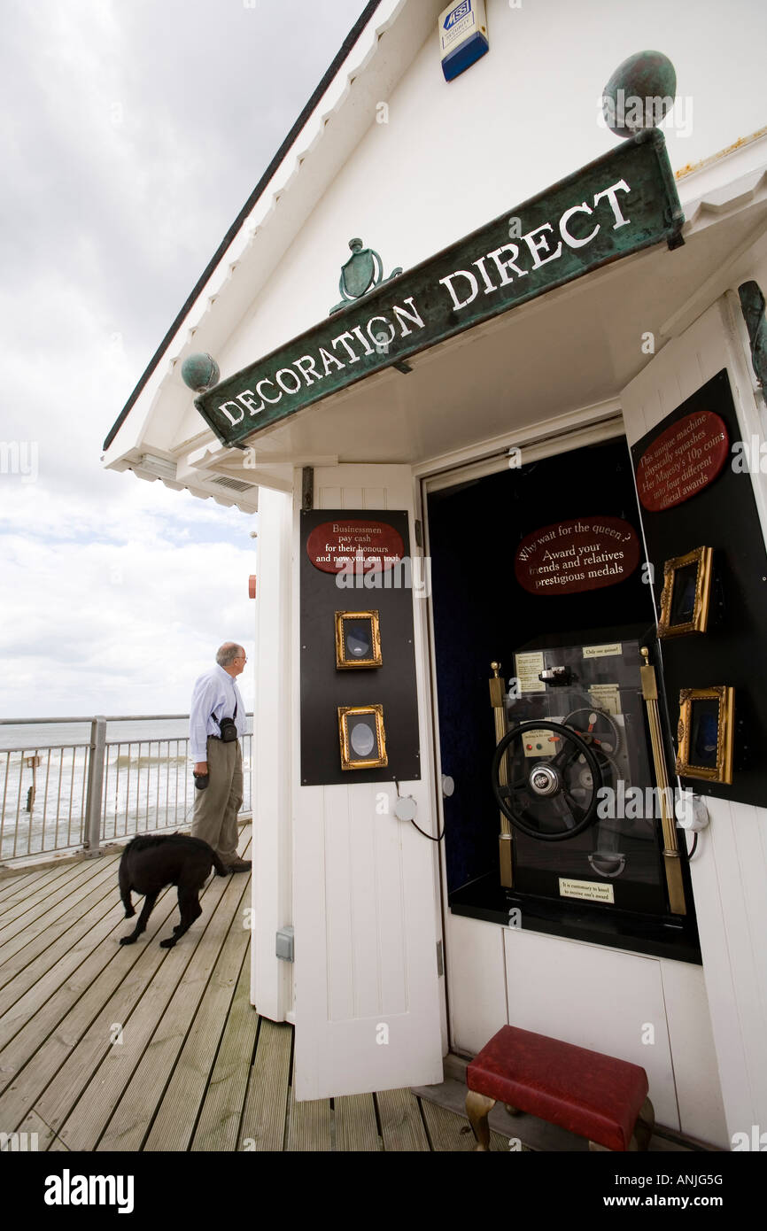 UK Suffolk Southwold pier cash for honours machine invented by Tim Hunkin - Stock Image