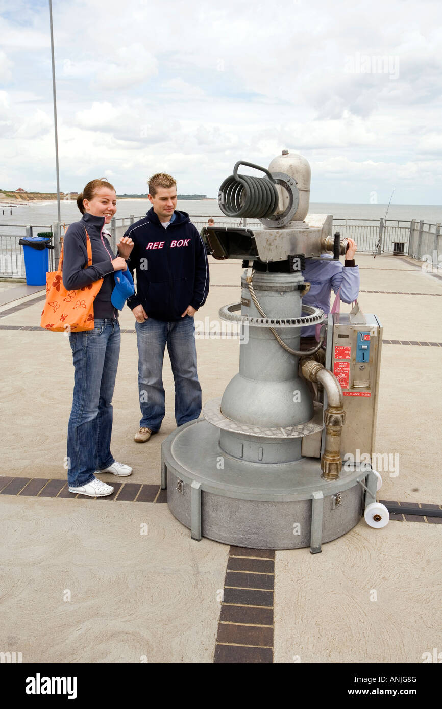 UK Suffolk Southwold Pier visitor looking through Tim Hunkins tunnelling telescope - Stock Image