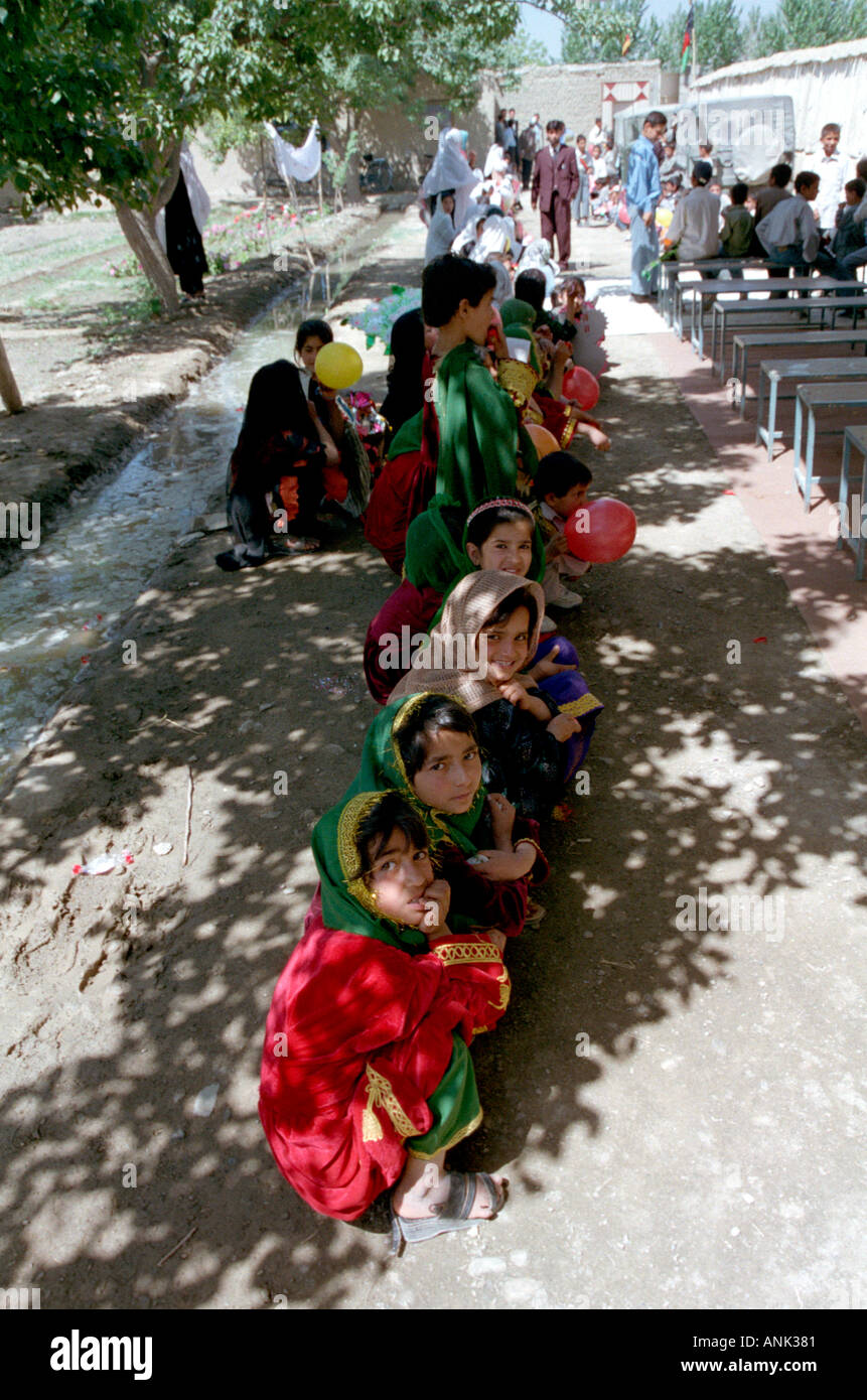 Afghan School Girls Stock Photos Images Blouse Rahmat Flower In Tranditional Dress Wait The Shade For Arrival Of Teachers