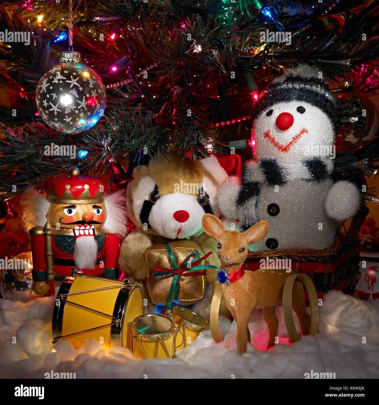 Toys Under The Christmas Tree With Lights And Ornaments Stock Photo