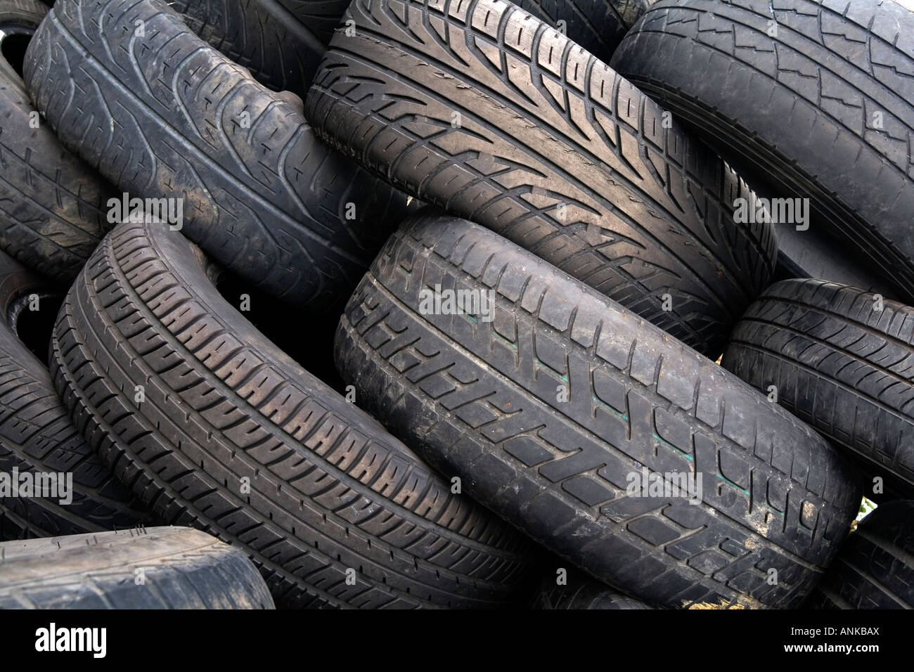 Rubber tyres piled up before recycling - Stock Image