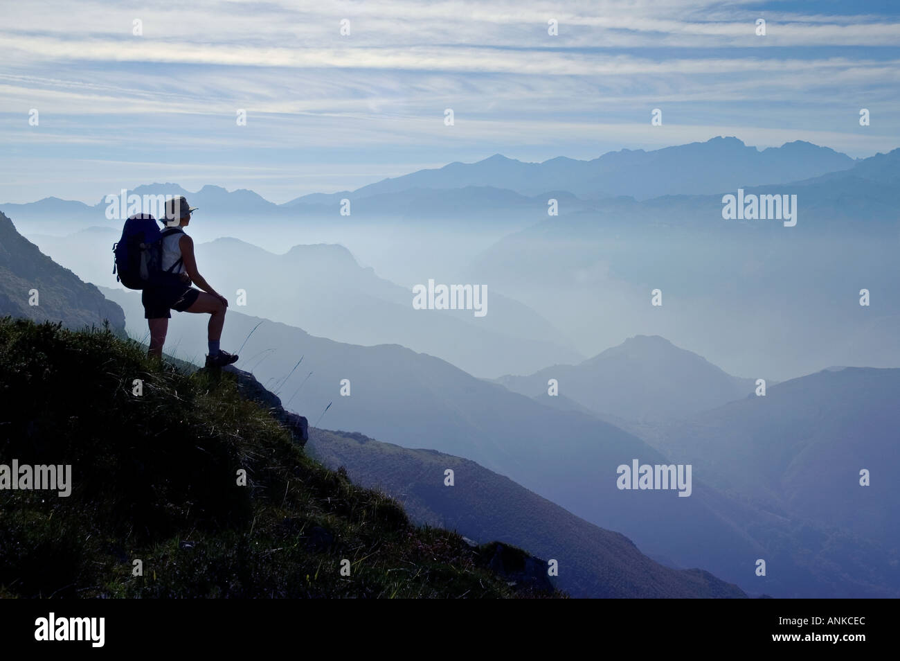 Single older woman hiker walker looks out over the Picos de Europa contemplating the future and the past Healthy woman post meno - Stock Image