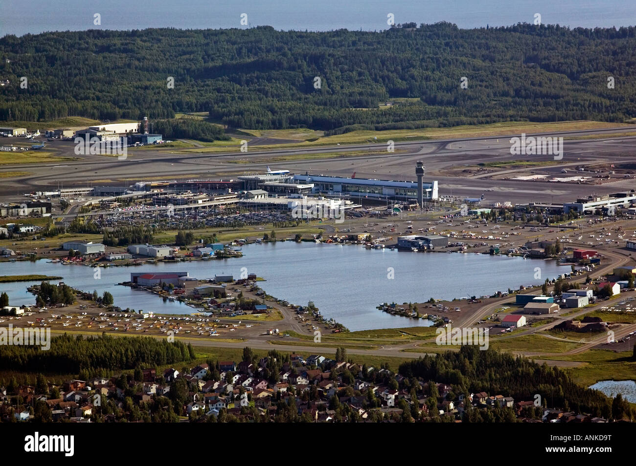 aerial above Ted Stevens Anchorage International airport (ANC) and Lake Hood seaplane base Alaska - Stock Image