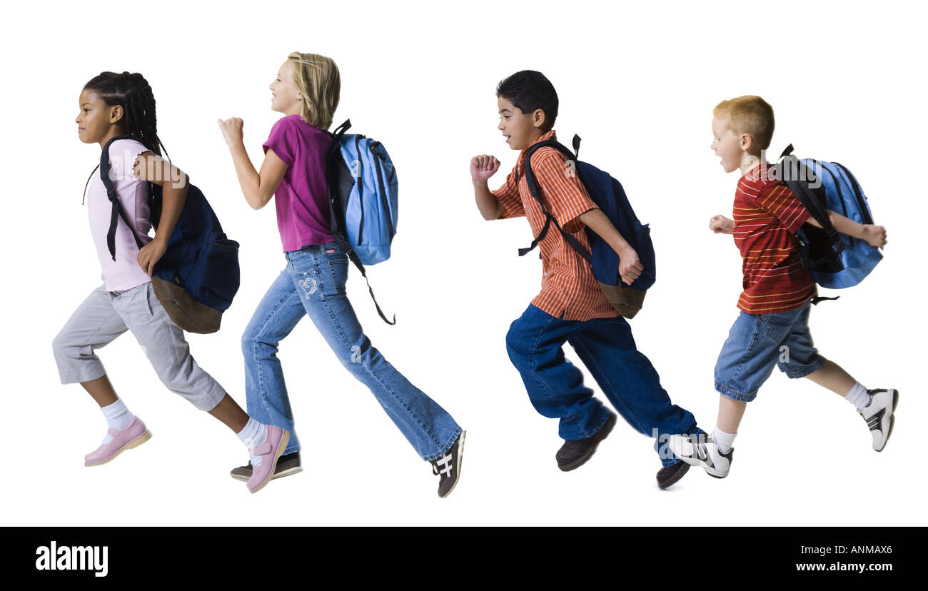 Profile of four children running in a row Stock Photo