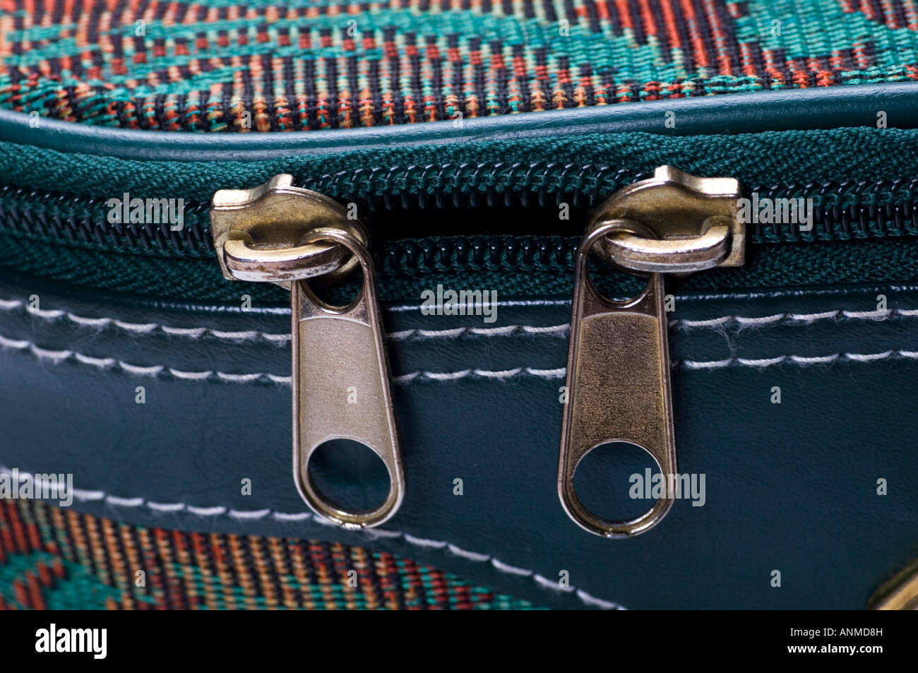 Zipper tabs of a traveling case - Stock Image