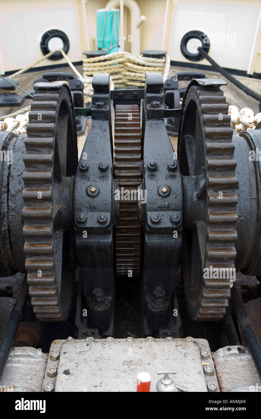 Gear wheels of a steam powered winch onboard ship - Stock Image