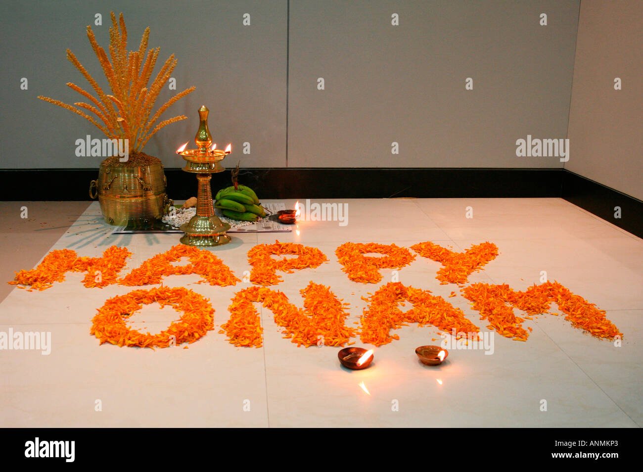 Onam greetings stock photos onam greetings stock images alamy onam greetings written on floor with flowers before a traditional kerala style decoration stock image m4hsunfo