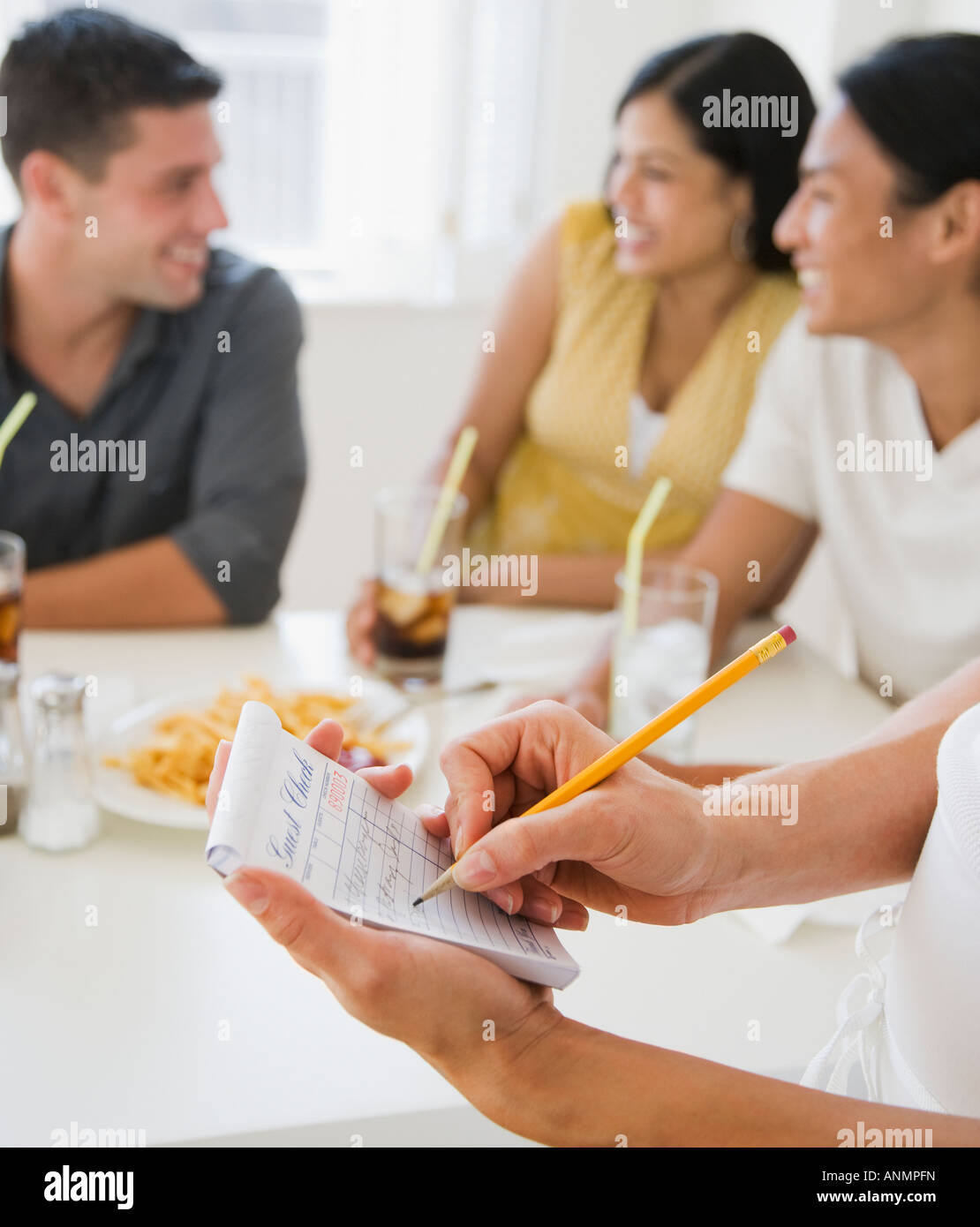Waitress taking order at diner - Stock Image