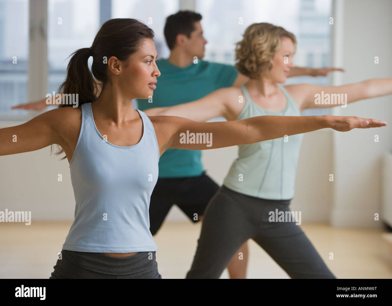 Multi-ethnic people in yoga class Stock Photo