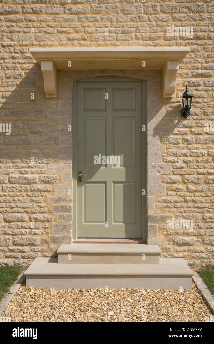 Uk Real Estate New House Painted Front Door In Stone Wall Stock Photo Alamy
