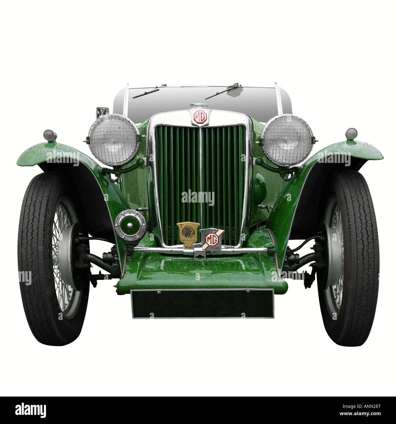 A Vintage MG sports car in British Racing Green isolated on white - Stock Image