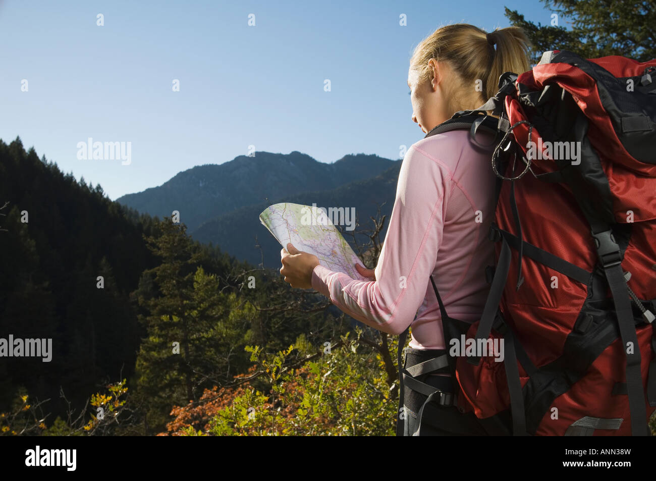 Female hiker looking at map, Utah, United States - Stock Image
