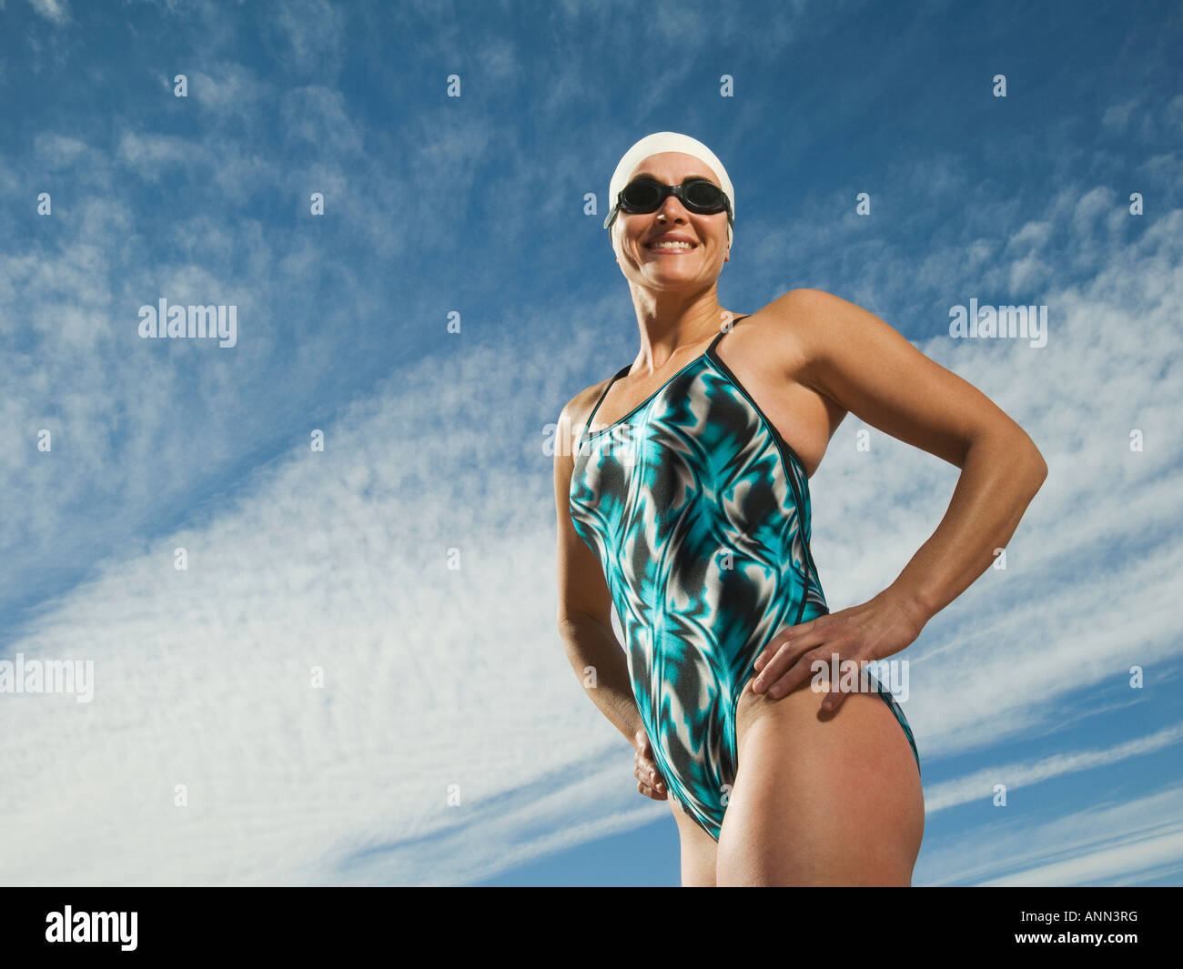 Female swimmer with hands on hips, Utah, United States - Stock Image
