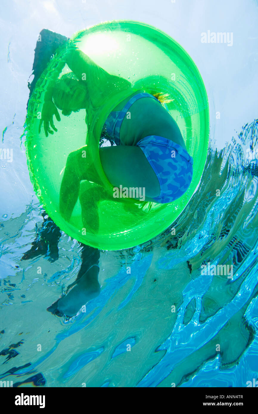 Underwater shot of child in inner tube, Florida, United States - Stock Image