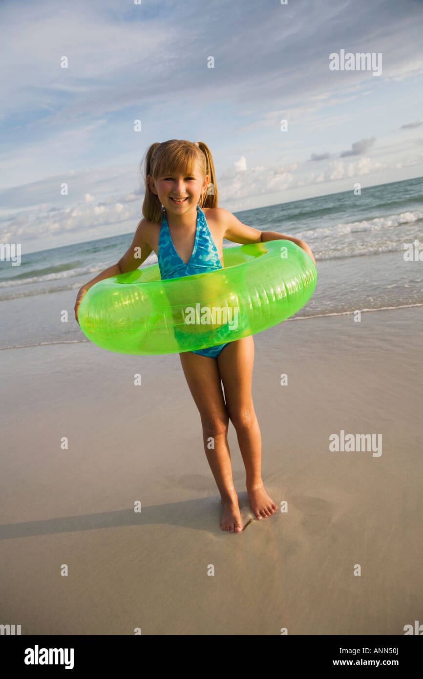 Girl in inner tube at beach, Florida, United States - Stock Image