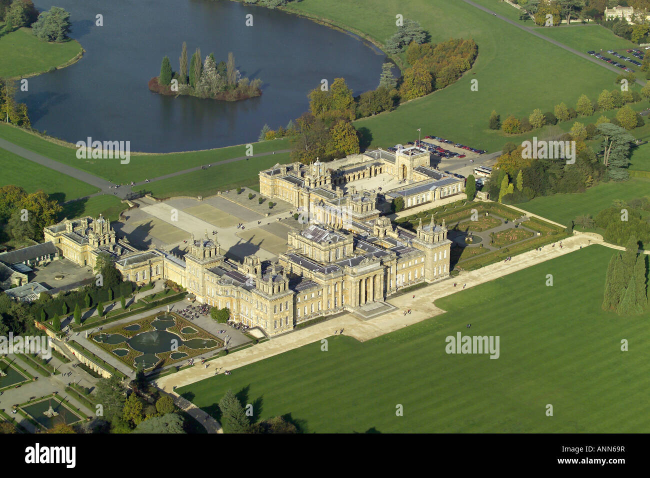 Aeiral view of Blenheim Palace with it's lake and formal gardens near Woodstock in Oxfordshire, once home to Winston Stock Photo