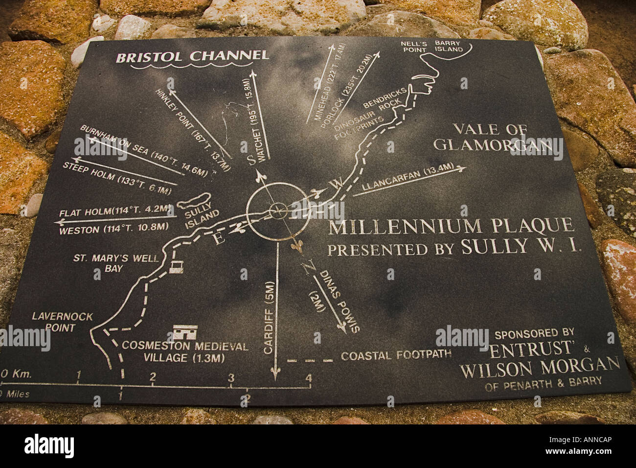 Millennium Plaque of directions and distances to local landmarks and villages on coastal footpath behind Sully beach - Stock Image