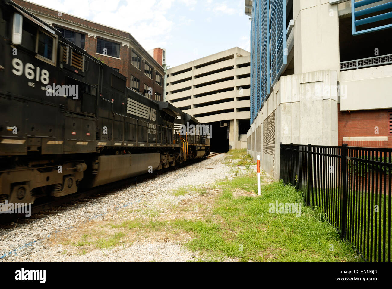 Series of  Rail Road Train going under parking garage in Columbus Ohio - Stock Image
