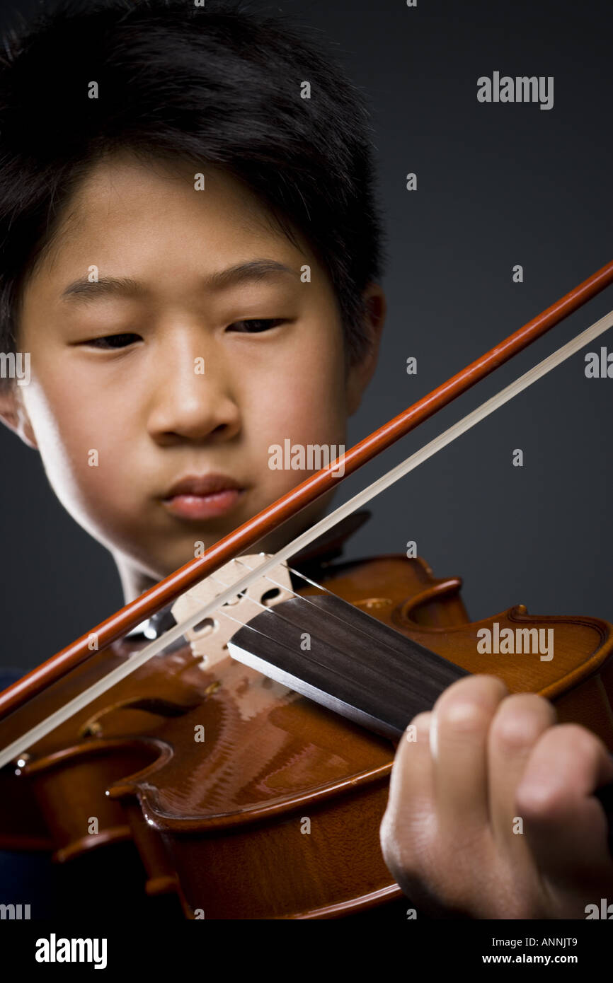 Close up of a boy playing the violin Stock Photo: 8897288