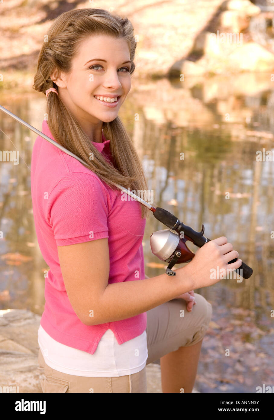 Teen Girl (15-17) At Pond, Holding Fishing Rod And Reel