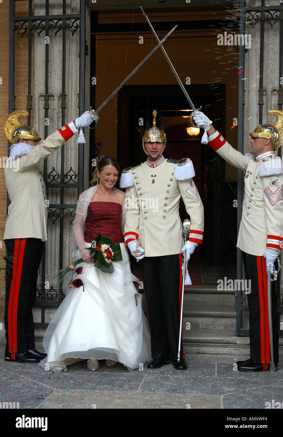 In Rome crossed swords and full dress uniforms mark the Campidoglio wedding of a Presidential guardsman and his bride - Stock Image