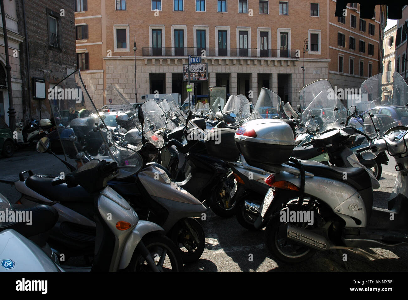 Parked scooters, a few among many, in central Rome - Stock Image