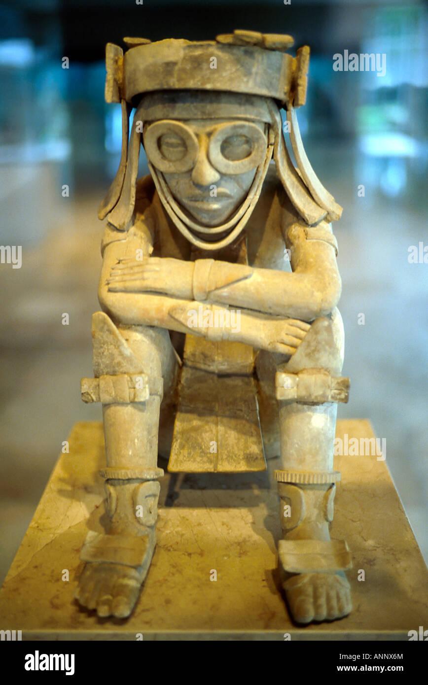 Sculpted pre Mayan civilization era clay figure, Xipe Totec God of Spring Museo de Antropologia Veracruz Mexico - Stock Image