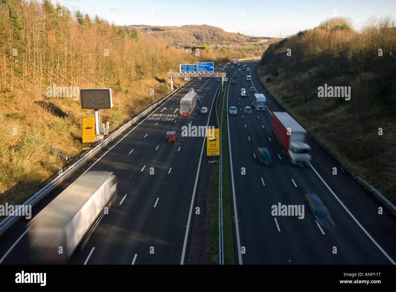 Horizontal view of lots of traffic speeding along the M4 motorway towards Cardiff on a bright sunny day Stock Photo