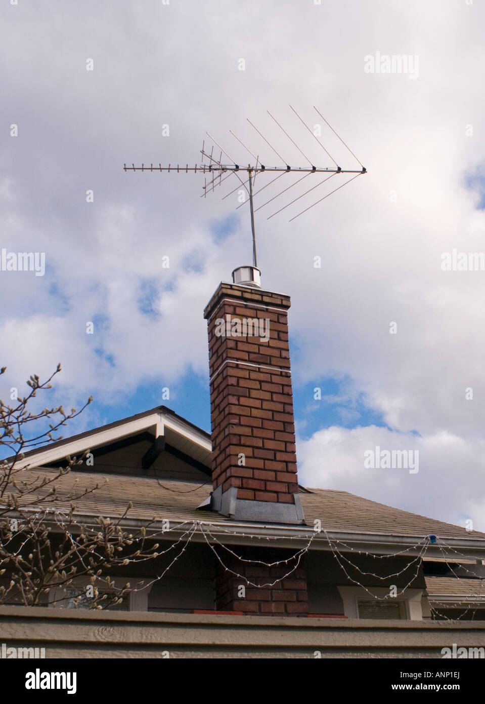 Analog television antenna on a chimney on a house in the North End of Tacoma, WA, USA. - Stock Image