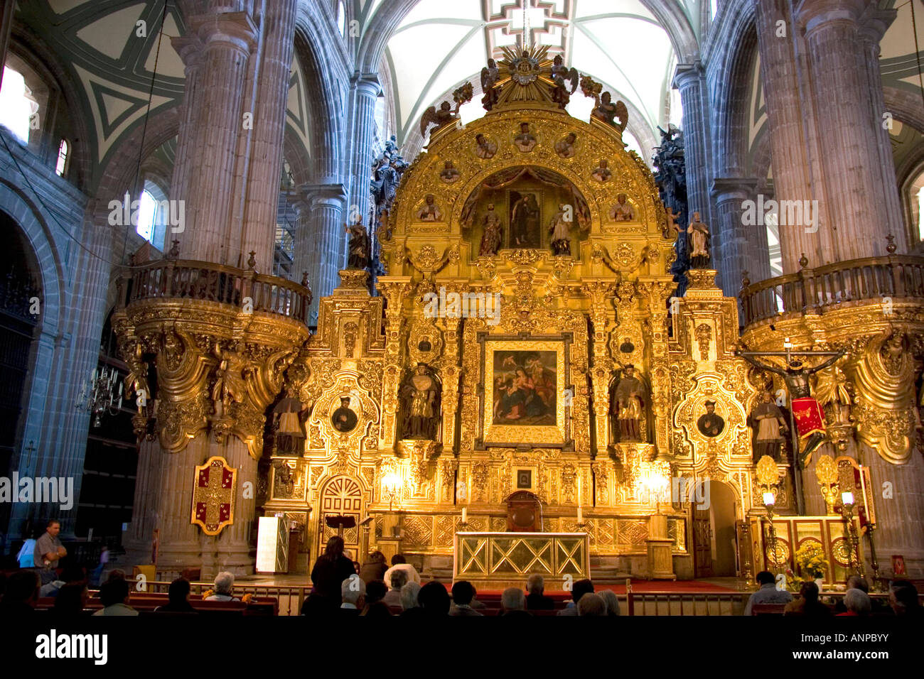 A gold alter in the Catedral Metropolitana located on the zocalo Mexico City Mexico - Stock Image