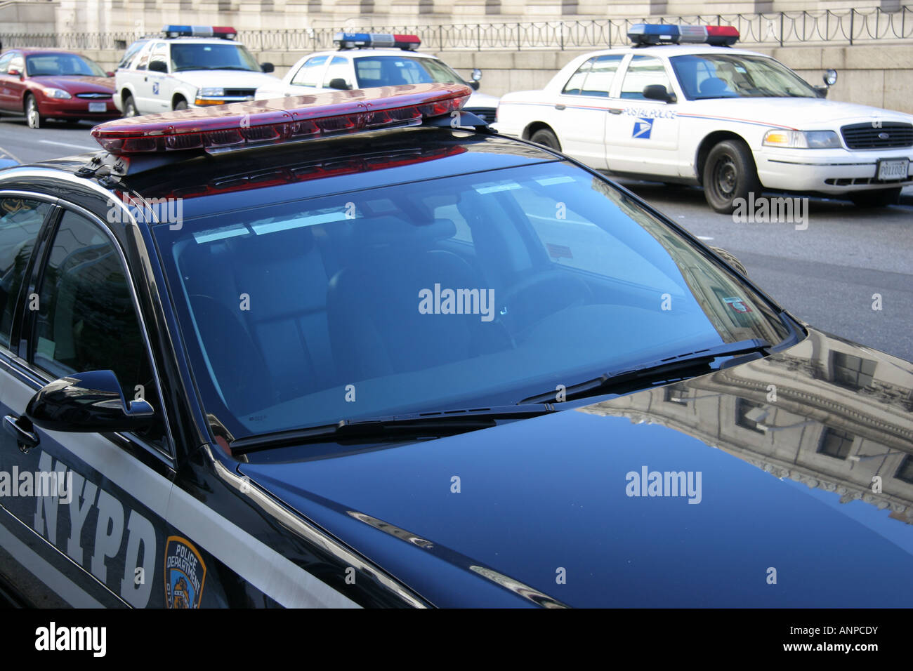 NYPD traffic car and US Postal Police vehicles - Stock Image