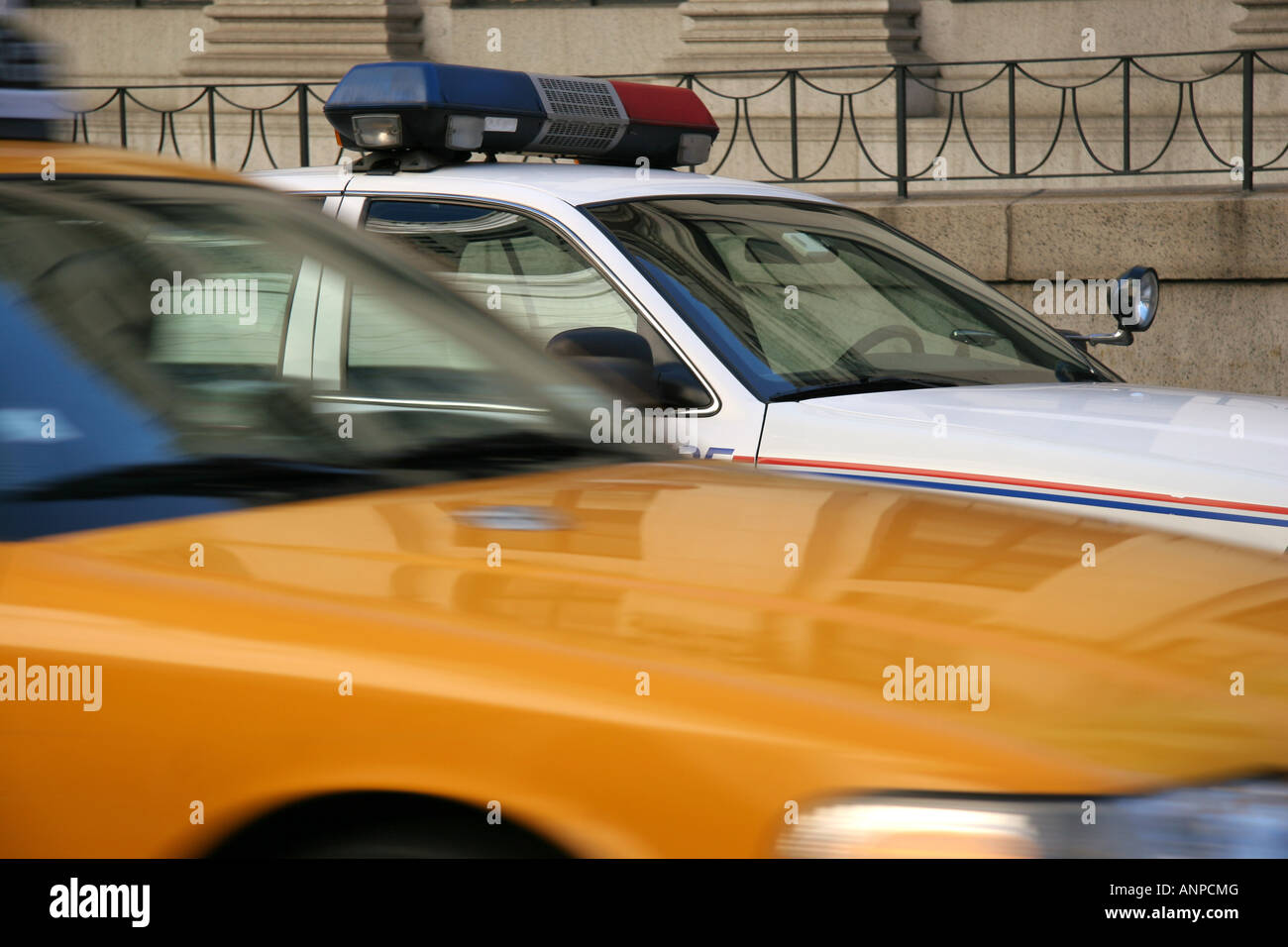 New York taxi and Postal Police car - Stock Image