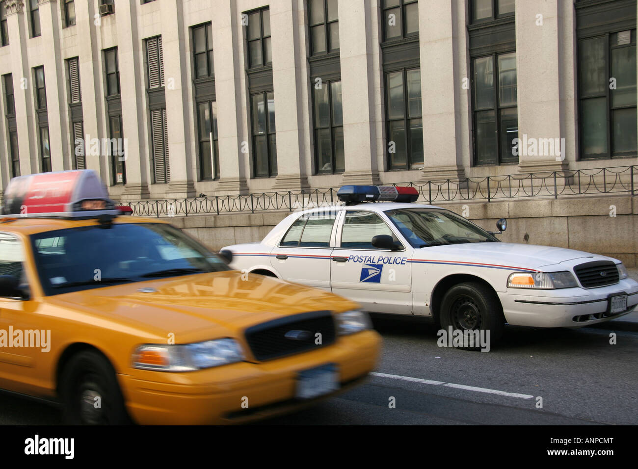 New York taxi and Postal Police car Stock Photo