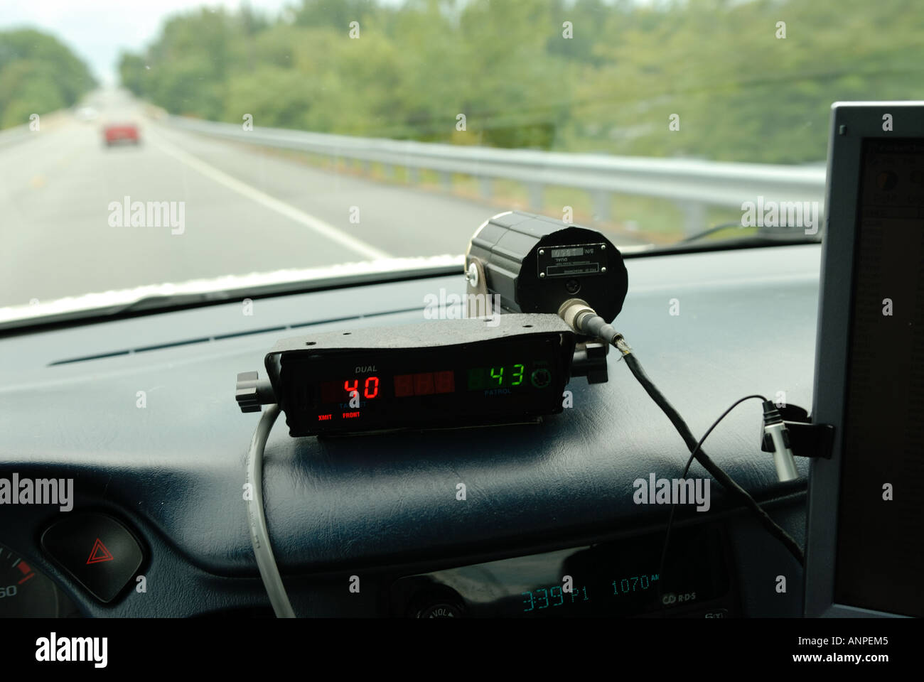 police speed radar unit in police car driving on 2 lane road stock photo 8901828 alamy. Black Bedroom Furniture Sets. Home Design Ideas