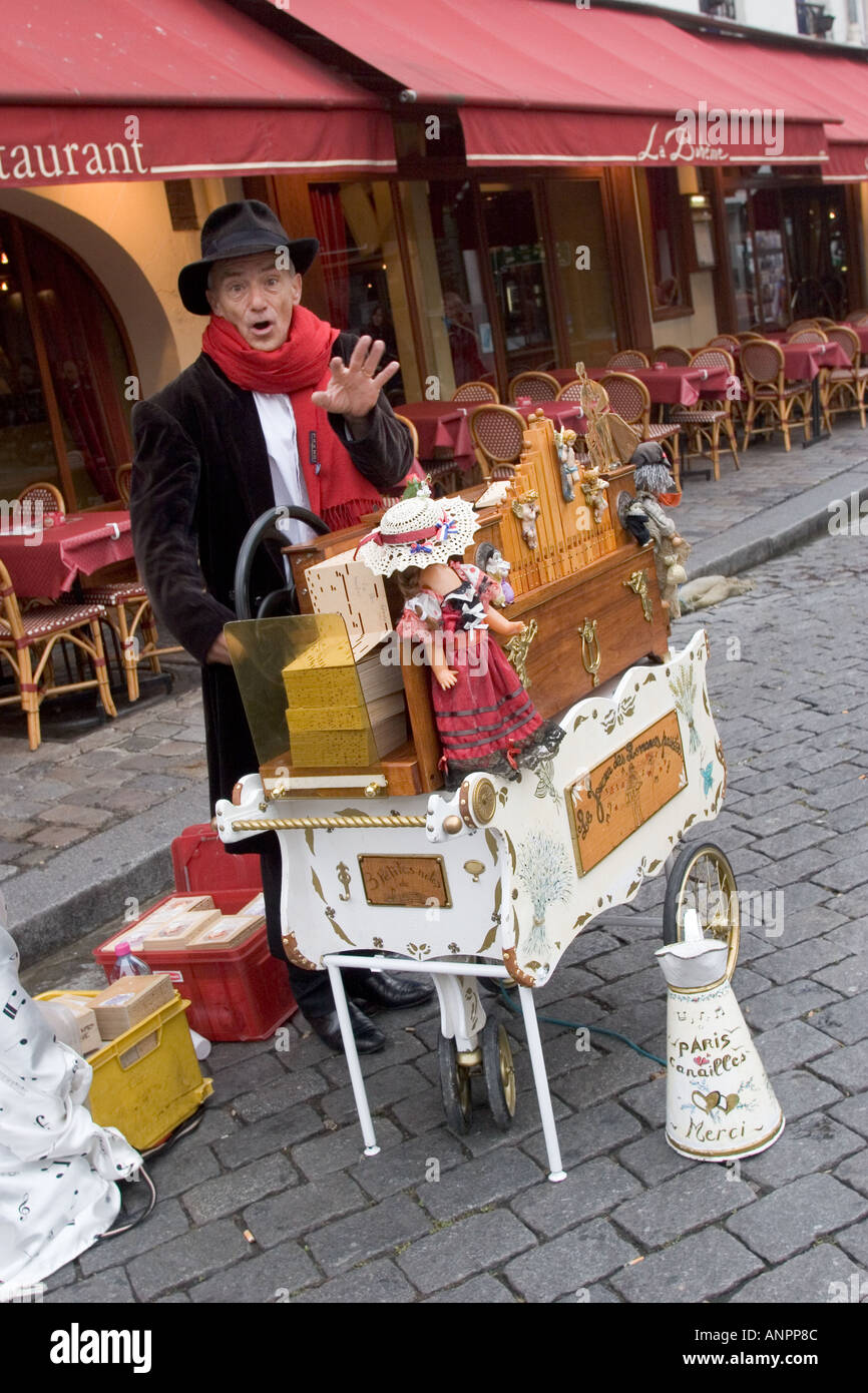 Street musician playing organ and singing in the Place du Tertre Montmartre Paris France - Stock Image