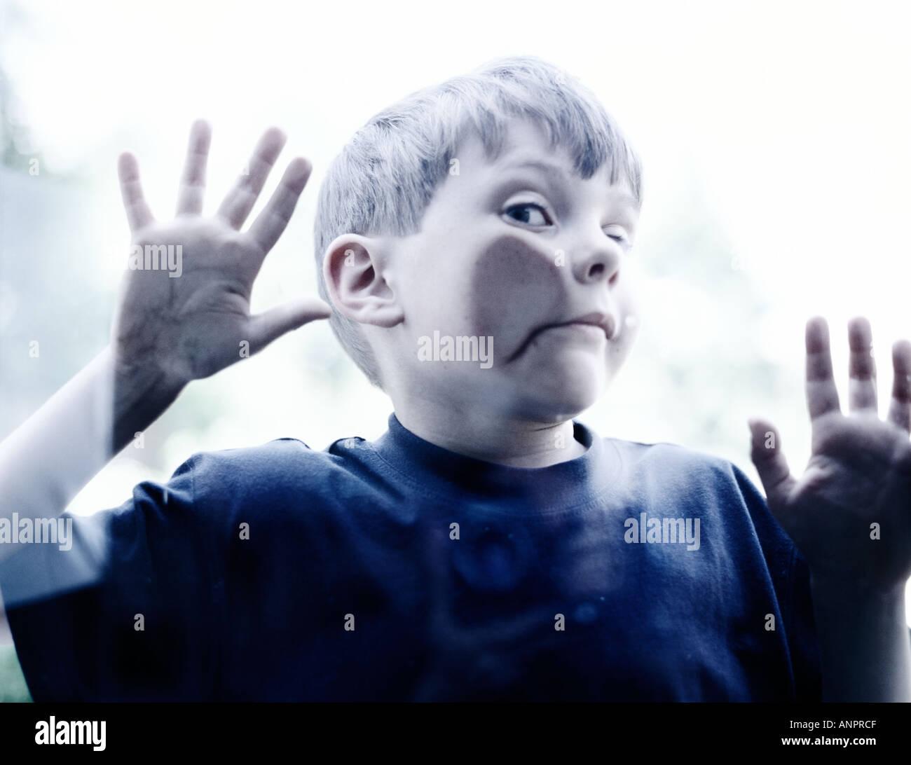 small-boy-pressing-his-cheek-against-som