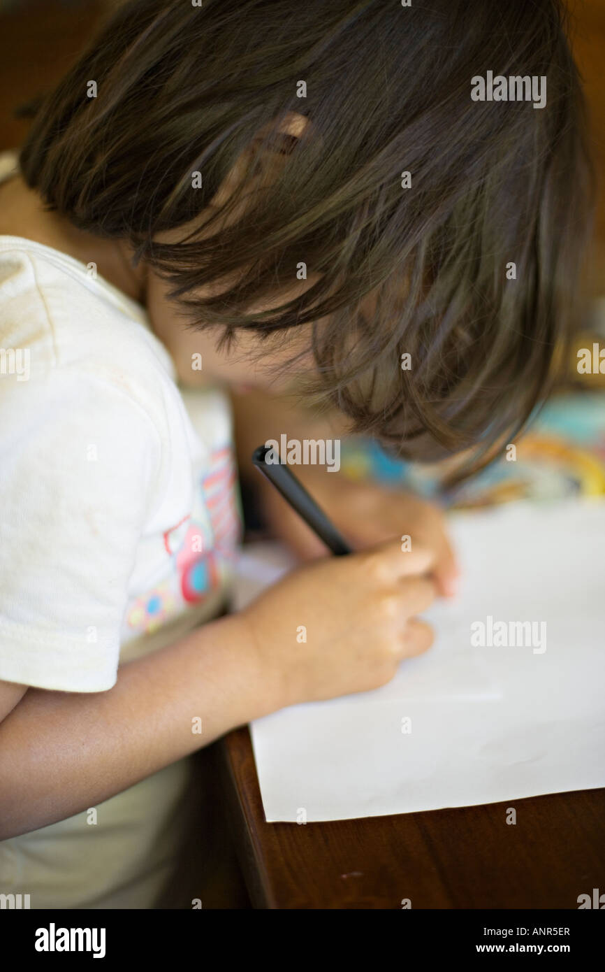 Child at play with paper - Stock Image