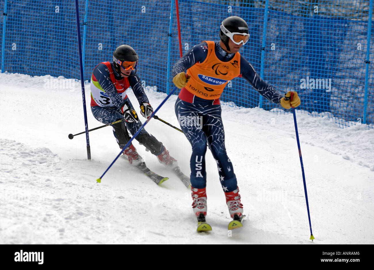 Andrew Parr of the USA follows the shouts of his guide in the Mens Alpine Skiing Slalom Visually Impaired competition - Stock Image