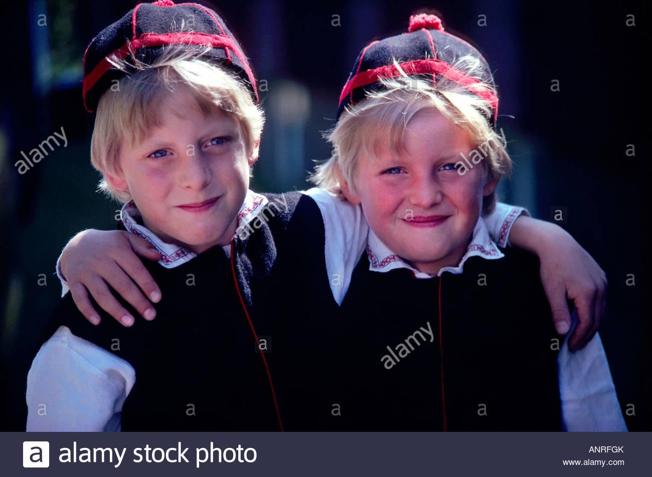 Two Swedish brothers in native costume celebrating Midsummer in Siljansnas Dalarna Province Sweden - Stock Image