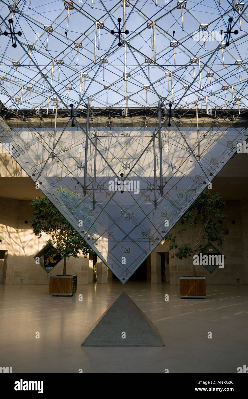 Interior view of inverted pyramid in the Musee Du Louvre Paris France - Stock Image