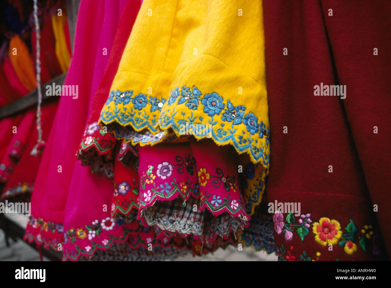 Ecuador Gualaceo market textiles detail of embroidered skirts - Stock Image