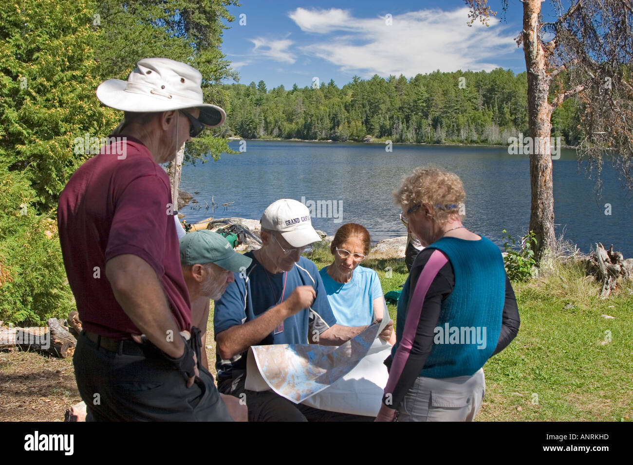 Quetico Provincial Park Ontario Canoe campers study a map at ... on woodland caribou provincial park map, gros morne national park, polar bear provincial park map, french river, killarney provincial park map, sleeping giant provincial park, pukaskwa national park, algonquin provincial park, quttinirpaaq national park, bruce peninsula national park, frontenac provincial park, sleeping giant provincial park map, awenda provincial park map, st. lawrence islands national park, bon echo provincial park, rainbow falls provincial park map, la mauricie national park map, lake superior provincial park, georgian bay islands national park, fathom five national marine park, lady evelyn-smoothwater provincial park map, french river provincial park map, wabakimi provincial park map, frontenac provincial park map, bon echo provincial park map, long point provincial park map, sandbanks provincial park map, killarney provincial park, finlayson point provincial park, rondeau provincial park map, duck mountain provincial park map, la verendrye provincial park map, ipperwash provincial park map, kawartha highlands provincial park map, nahanni national park reserve, polar bear provincial park, pinery provincial park map, lady evelyn-smoothwater provincial park, point pelee national park, sandbanks provincial park,