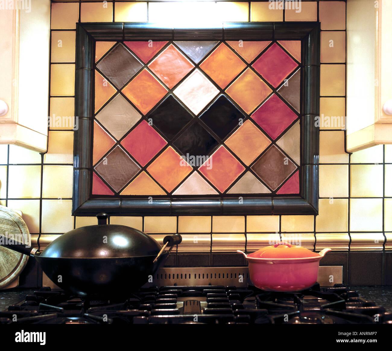 Tiling arrangement behind kitchen cooker - London - Stock Image