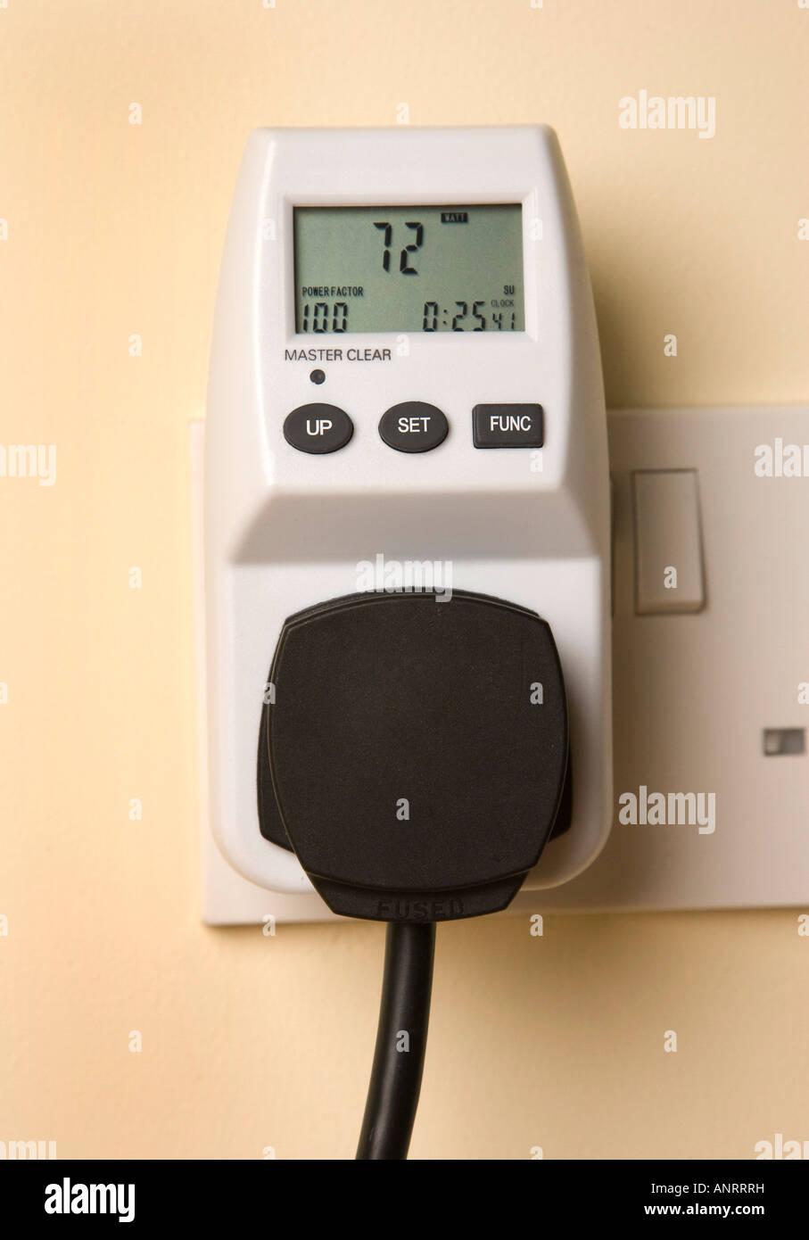 electronic device for measuring how much electricity / energy is consumed by electrical appliances - Stock Image