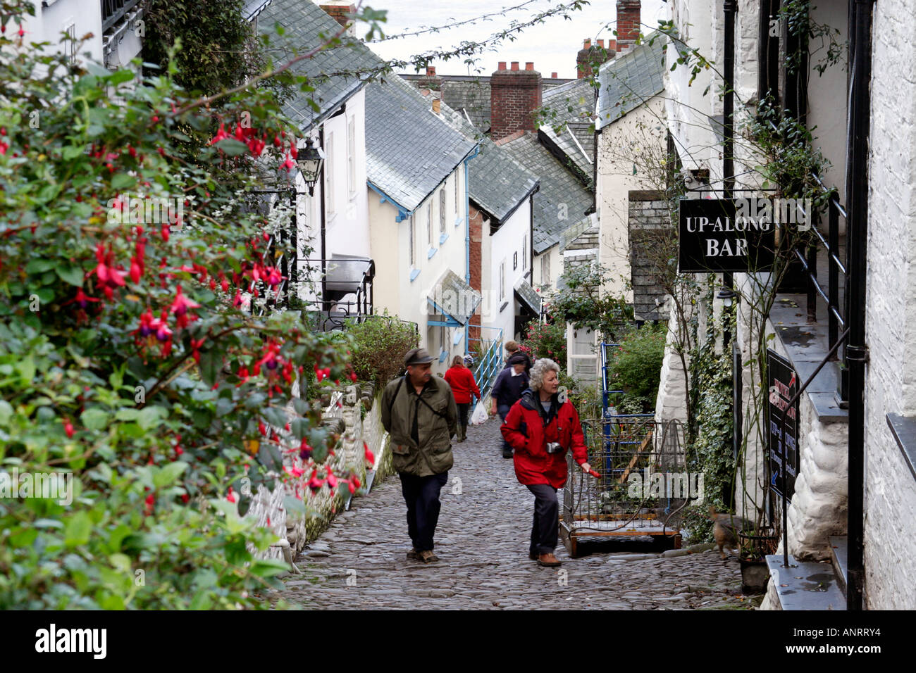 Visitors Walking Up Steep Hill In The Village Of Clovelly