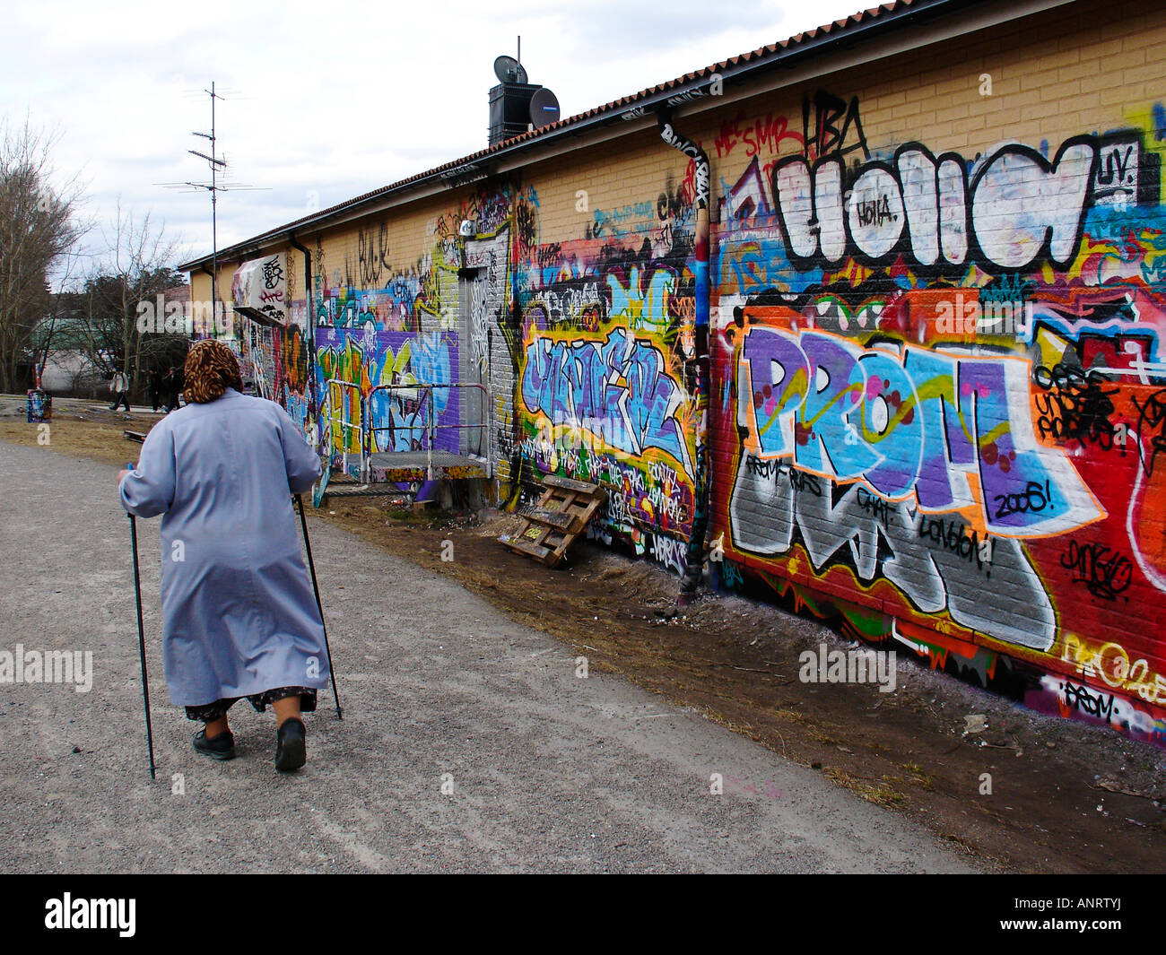 Old woman and graffitti - Stock Image