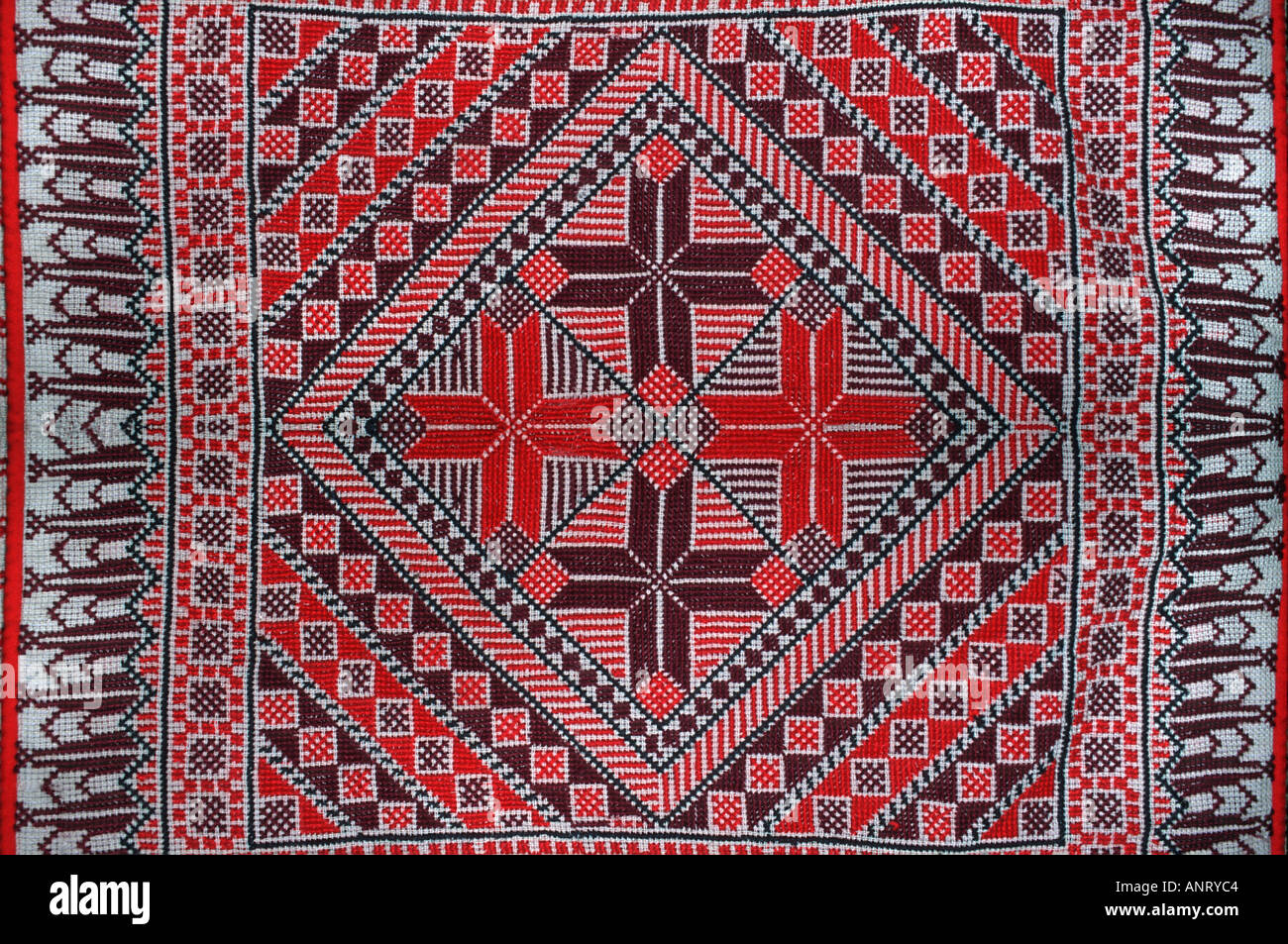 Jordanian Bedouin cross stitch embroidered silk textile Petra Jordan Middle East Stock Photo
