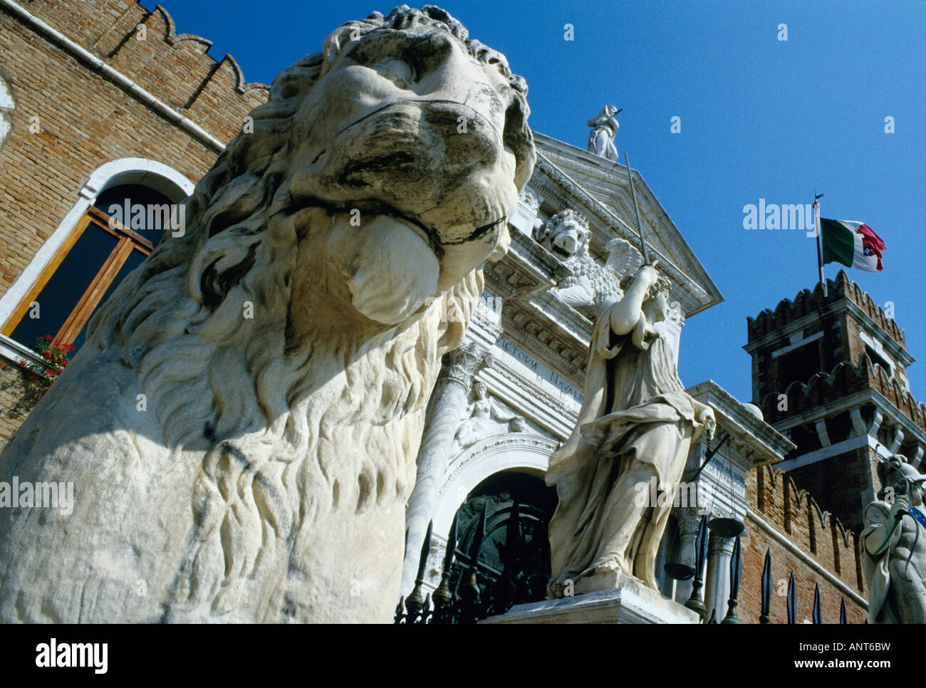 Venice Italy Lion statue stands on guard outside the gate of the Arsenale the old shipbuilding yard - Stock Image