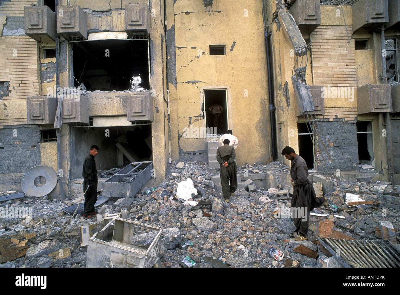 Iraqis inspecting demolished houses by US forces in Telafar Iraq - Stock Image